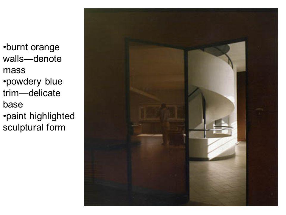 burnt orange walls—denote mass powdery blue trim—delicate base paint highlighted sculptural form