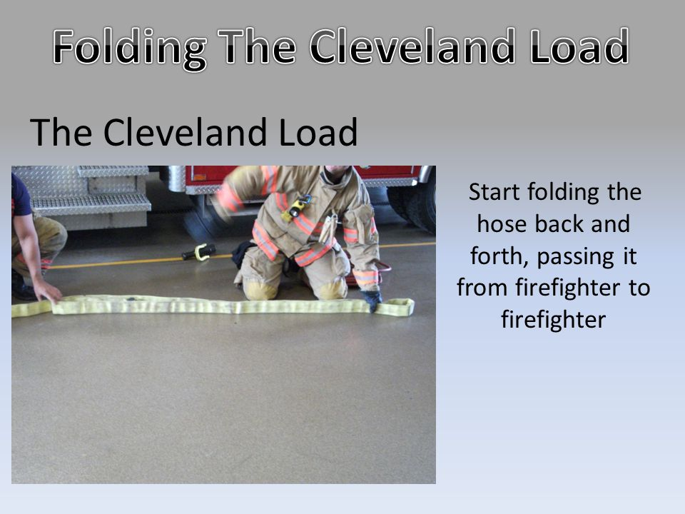 The Cleveland Load Start folding the hose back and forth, passing it from firefighter to firefighter