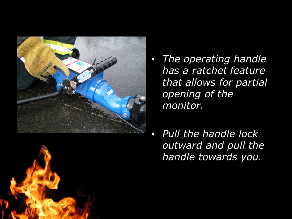 The operating handle has a ratchet feature that allows for partial opening of the monitor. Pull the handle lock outward and pull the handle towards yo