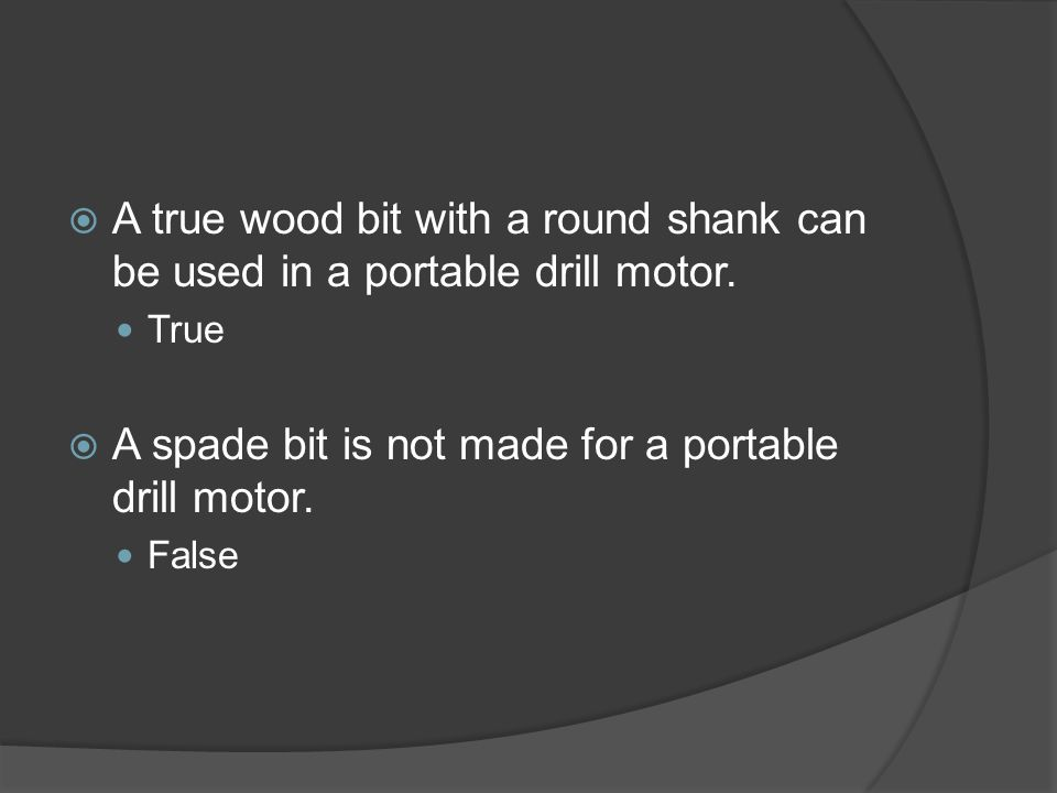  A true wood bit with a round shank can be used in a portable drill motor.