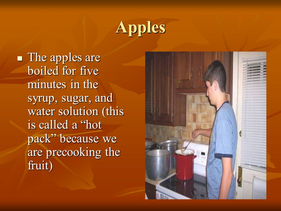Apples The sliced apples are placed in a large saucepan to be cooked in a light syrup The sliced apples are placed in a large saucepan to be cooked in a light syrup