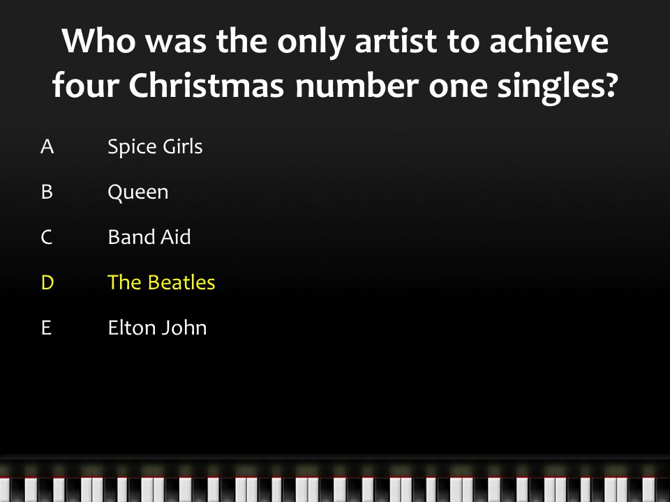 Who was the only artist to achieve four Christmas number one singles.
