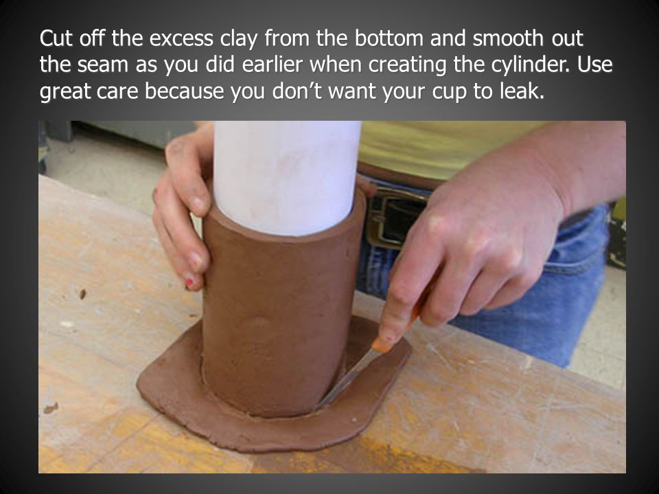 Cut off the excess clay from the bottom and smooth out the seam as you did earlier when creating the cylinder.