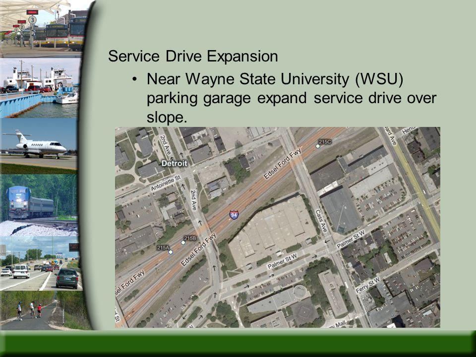 Service Drive Expansion Near Wayne State University (WSU) parking garage expand service drive over slope.
