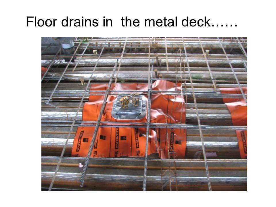 Floor drains in the metal deck……