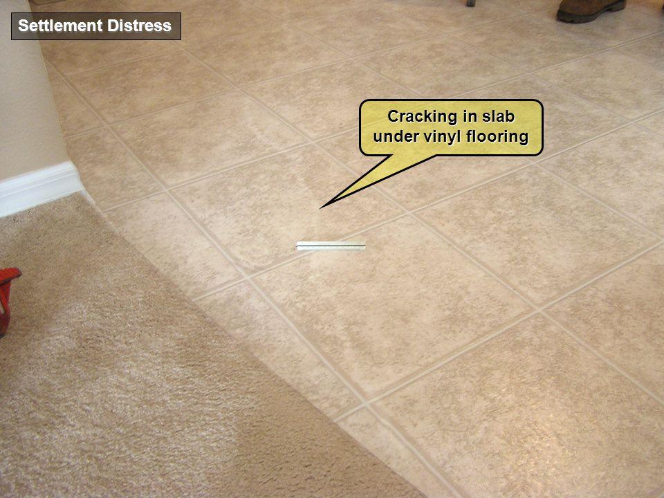 Settlement Distress Cracking in slab under vinyl flooring