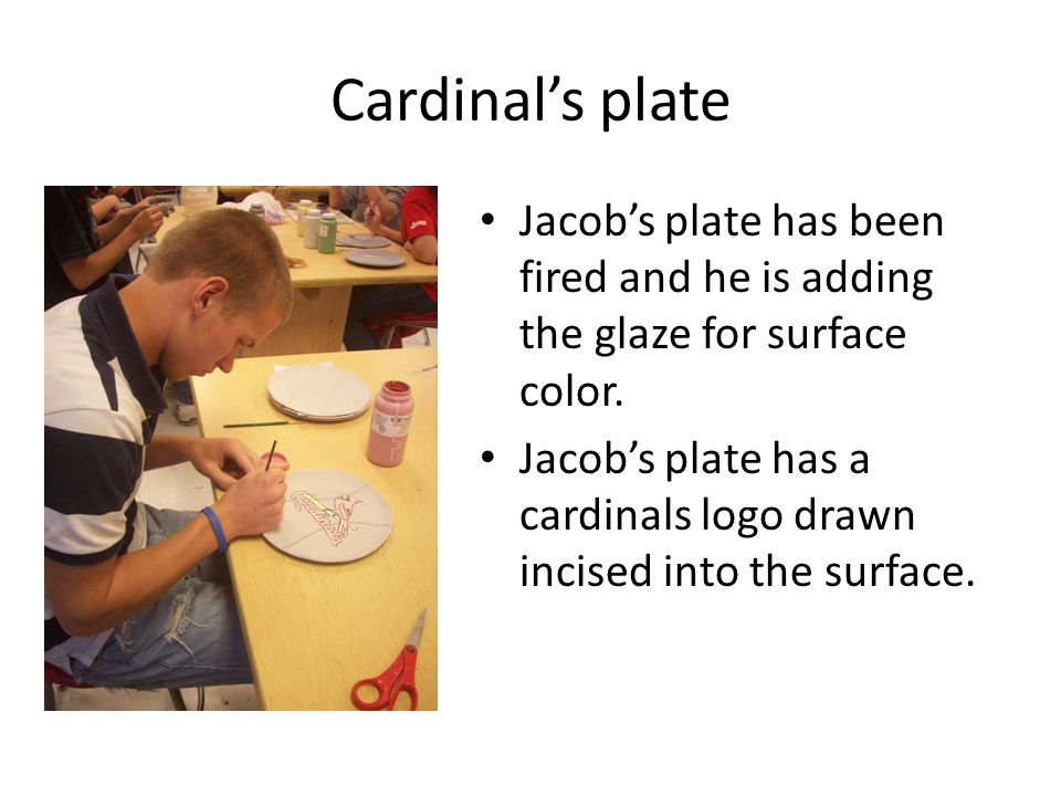 Cardinal's plate Jacob's plate has been fired and he is adding the glaze for surface color.
