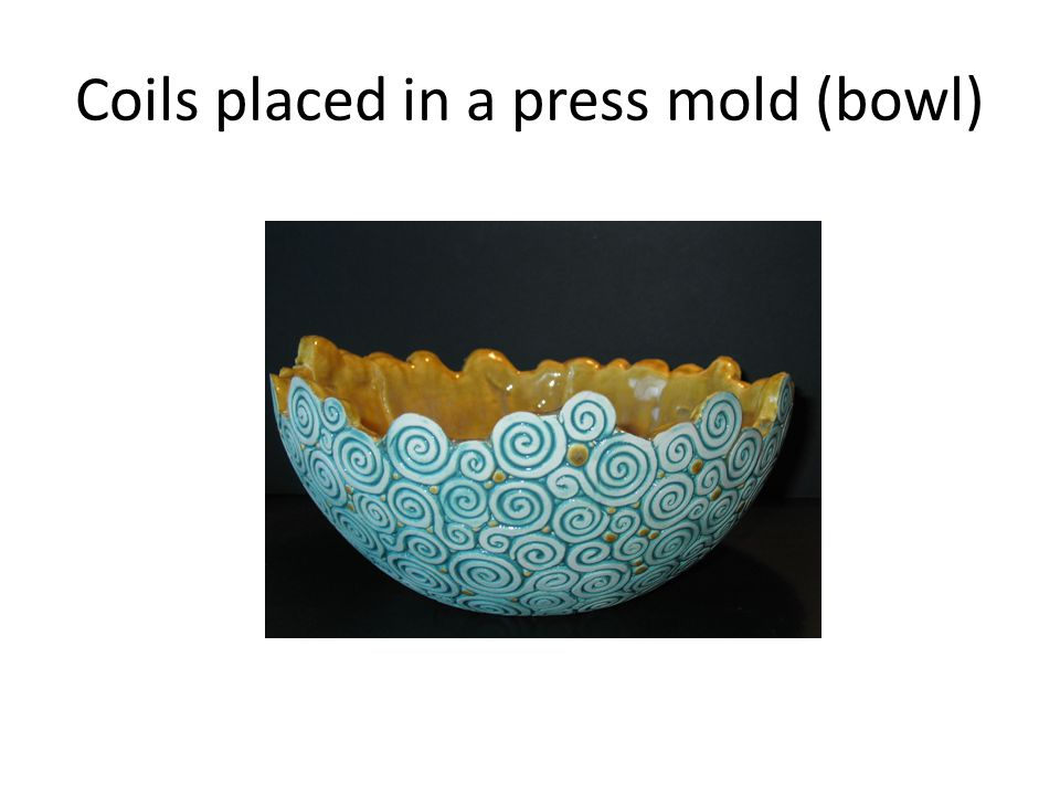 Coils placed in a press mold (bowl)