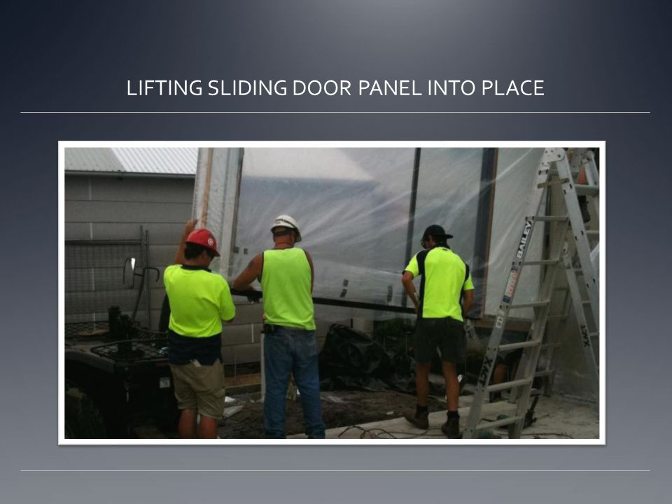 LIFTING SLIDING DOOR PANEL INTO PLACE