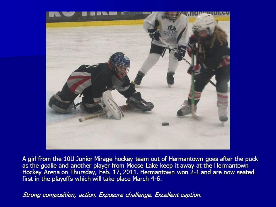 A girl from the 10U Junior Mirage hockey team out of Hermantown goes after the puck as the goalie and another player from Moose Lake keep it away at the Hermantown Hockey Arena on Thursday, Feb.