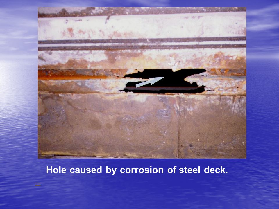 Hole caused by corrosion of steel deck.