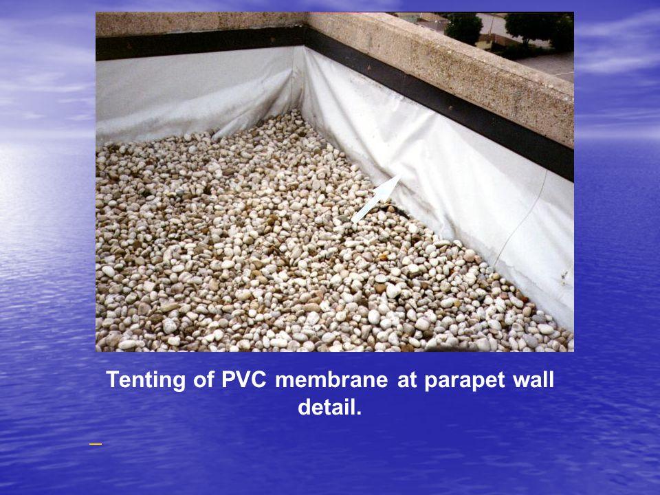 Tenting of PVC membrane at parapet wall detail.