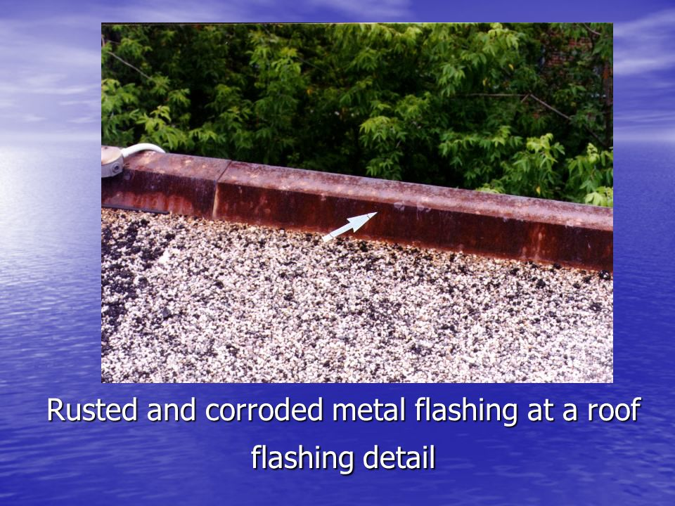 Rusted and corroded metal flashing at a roof flashing detail