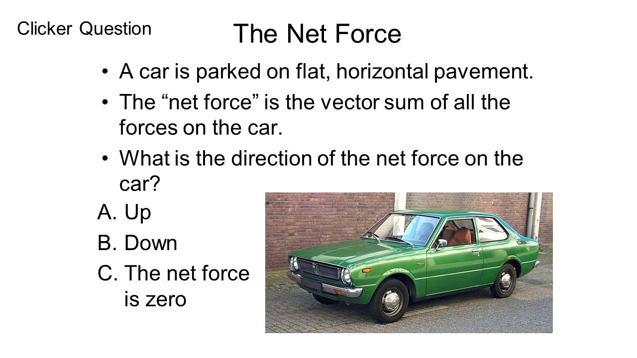 A car is parked on flat, horizontal pavement.
