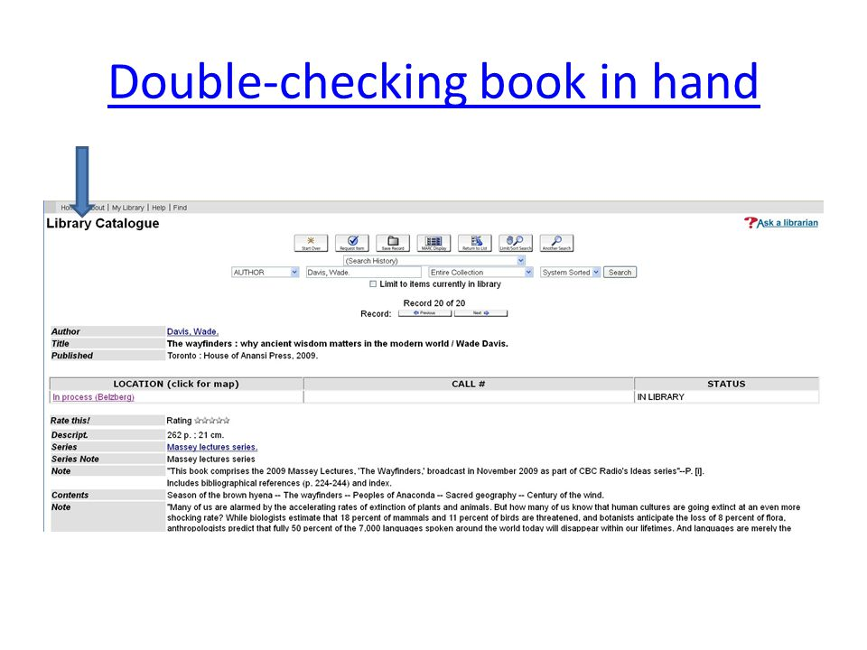 Double-checking book in hand