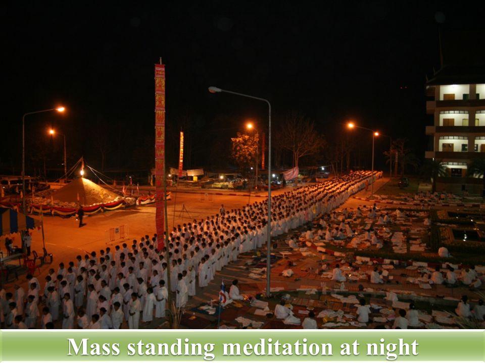 Mass standing meditation at night