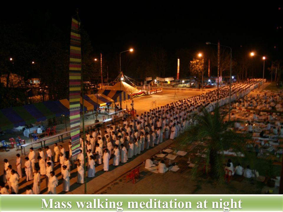 Mass walking meditation at night