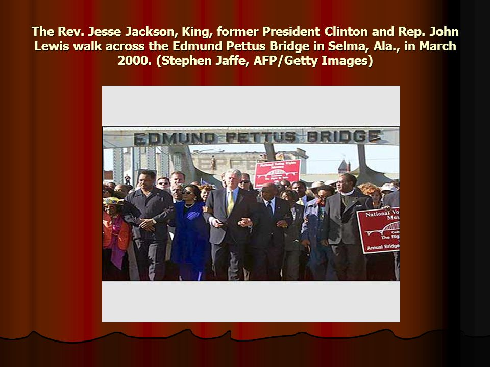 The Rev. Jesse Jackson, King, former President Clinton and Rep. John Lewis walk across the Edmund Pettus Bridge in Selma, Ala., in March 2000. (Stephe