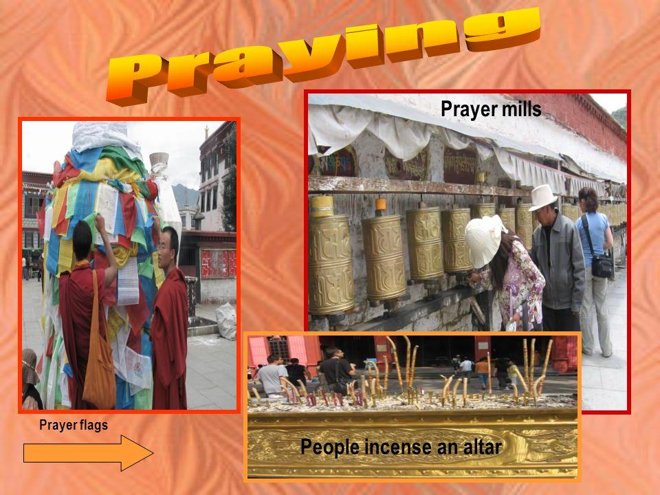 Prayer flags People incense an altar Prayer mills