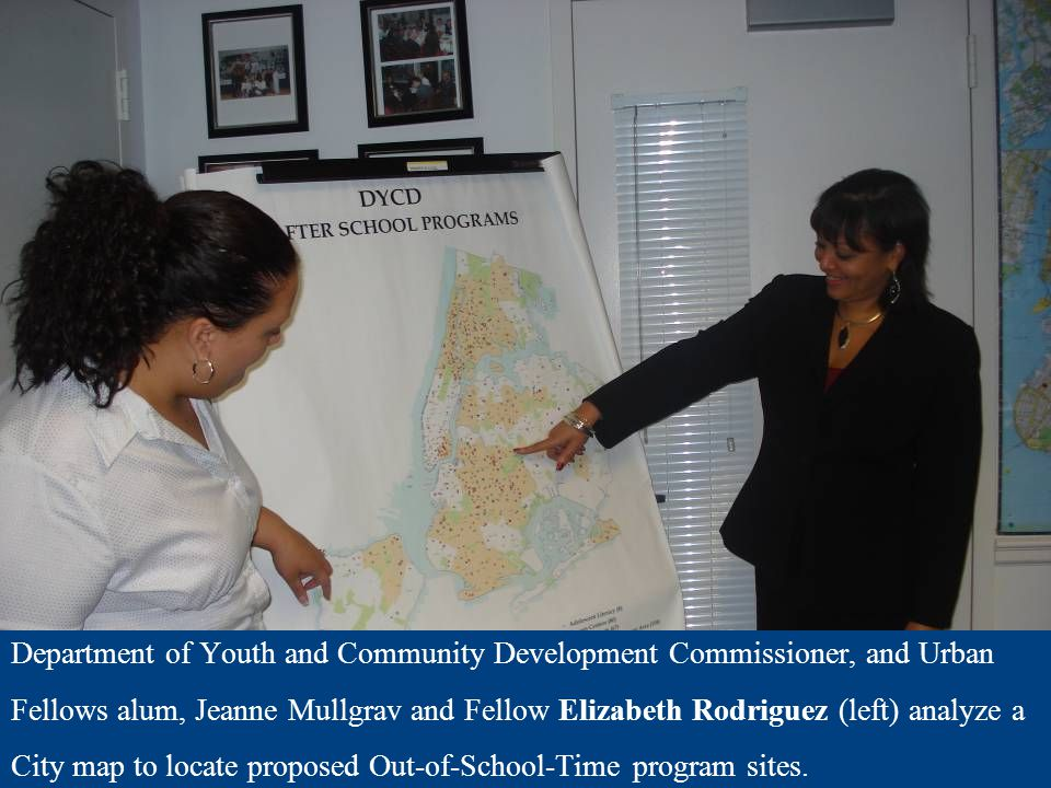 Department of Youth and Community Development Commissioner, and Urban Fellows alum, Jeanne Mullgrav and Fellow Elizabeth Rodriguez (left) analyze a Ci