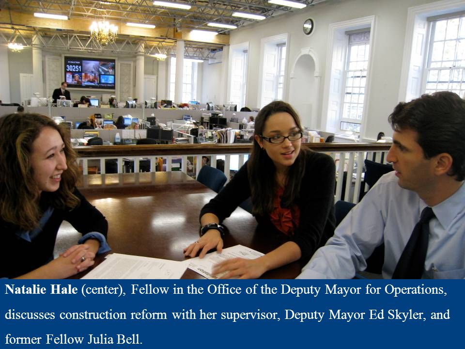 Natalie Hale (center), Fellow in the Office of the Deputy Mayor for Operations, discusses construction reform with her supervisor, Deputy Mayor Ed Sky