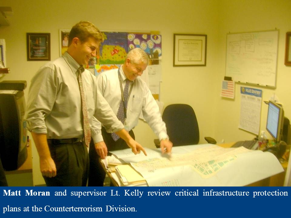Matt Moran and supervisor Lt. Kelly review critical infrastructure protection plans at the Counterterrorism Division.