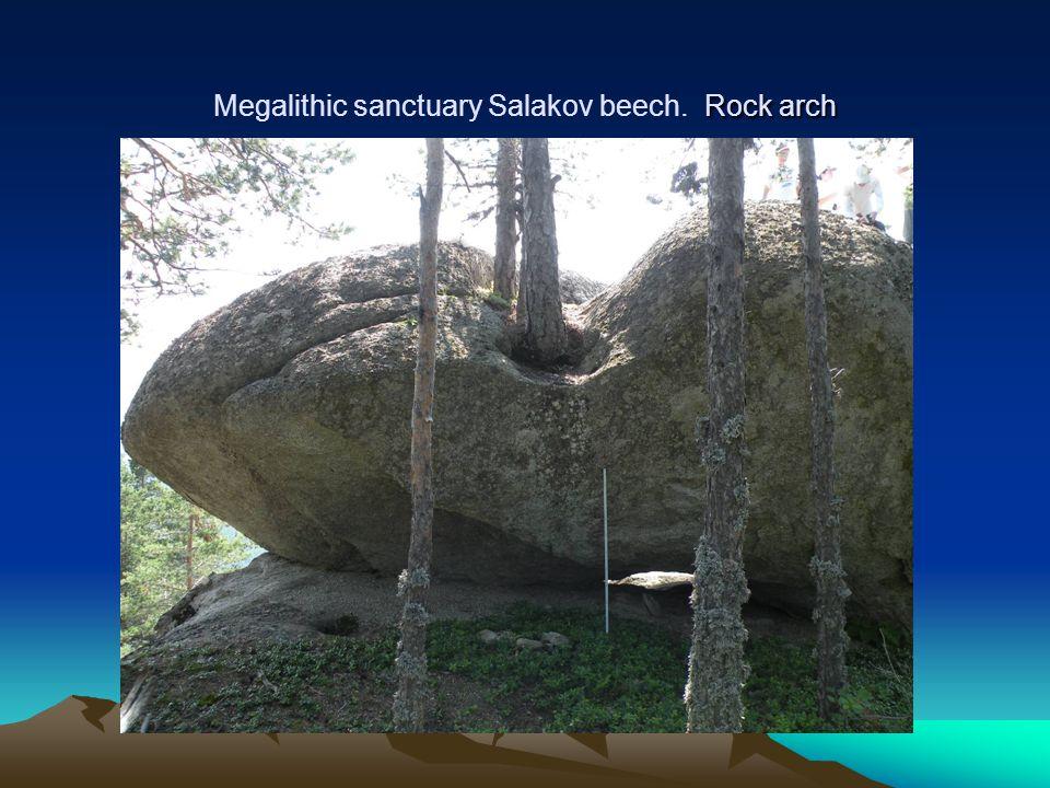 Rock arch Megalithic sanctuary Salakov beech. Rock arch