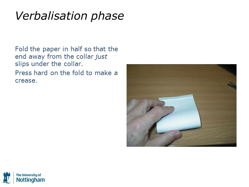 Verbalisation phase Fold the paper in half so that the end away from the collar just slips under the collar.