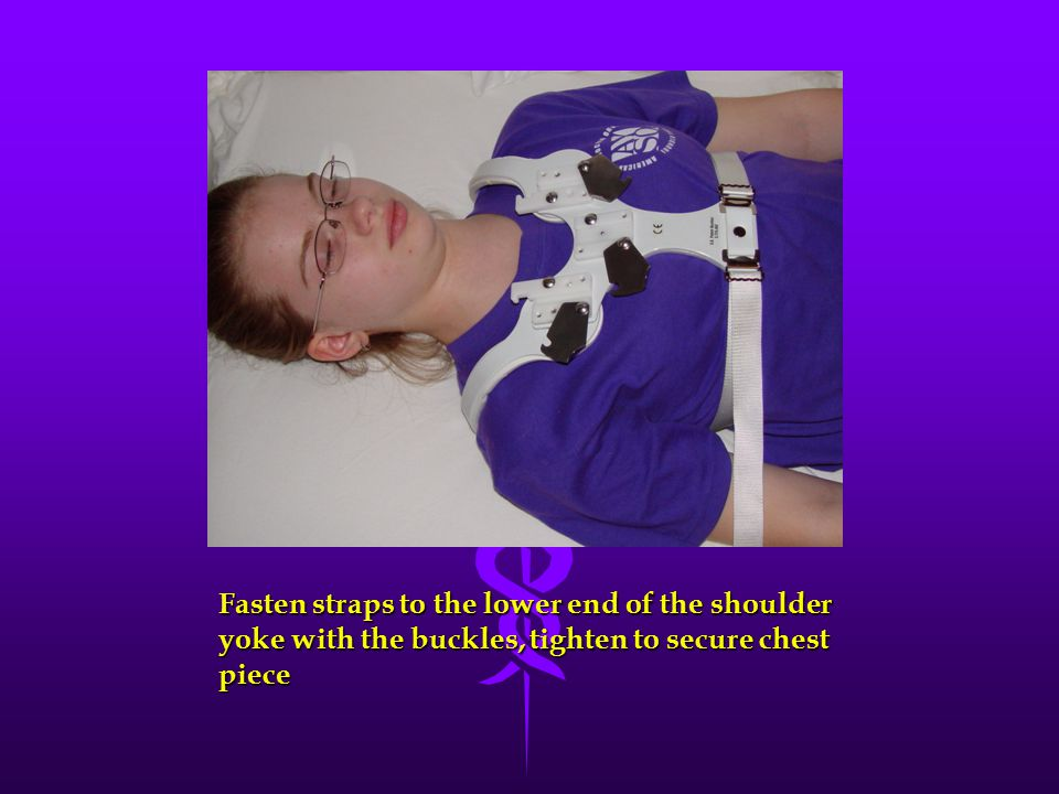 Fasten straps to the lower end of the shoulder yoke with the buckles, tighten to secure chest piece