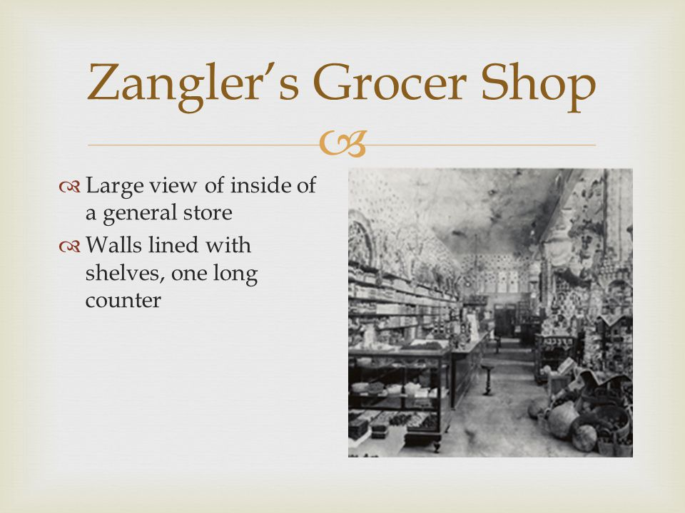  Zangler's Grocer Shop  Large view of inside of a general store  Walls lined with shelves, one long counter
