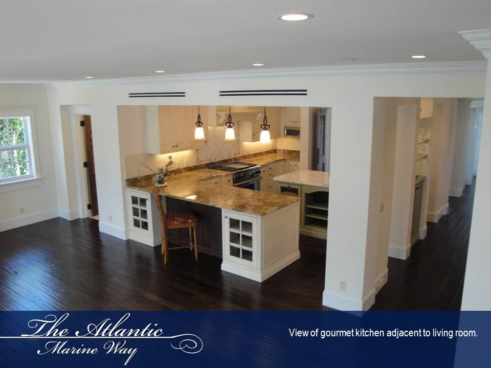 View of gourmet kitchen adjacent to living room.