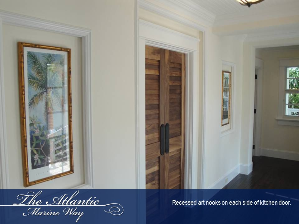 Recessed art nooks on each side of kitchen door.
