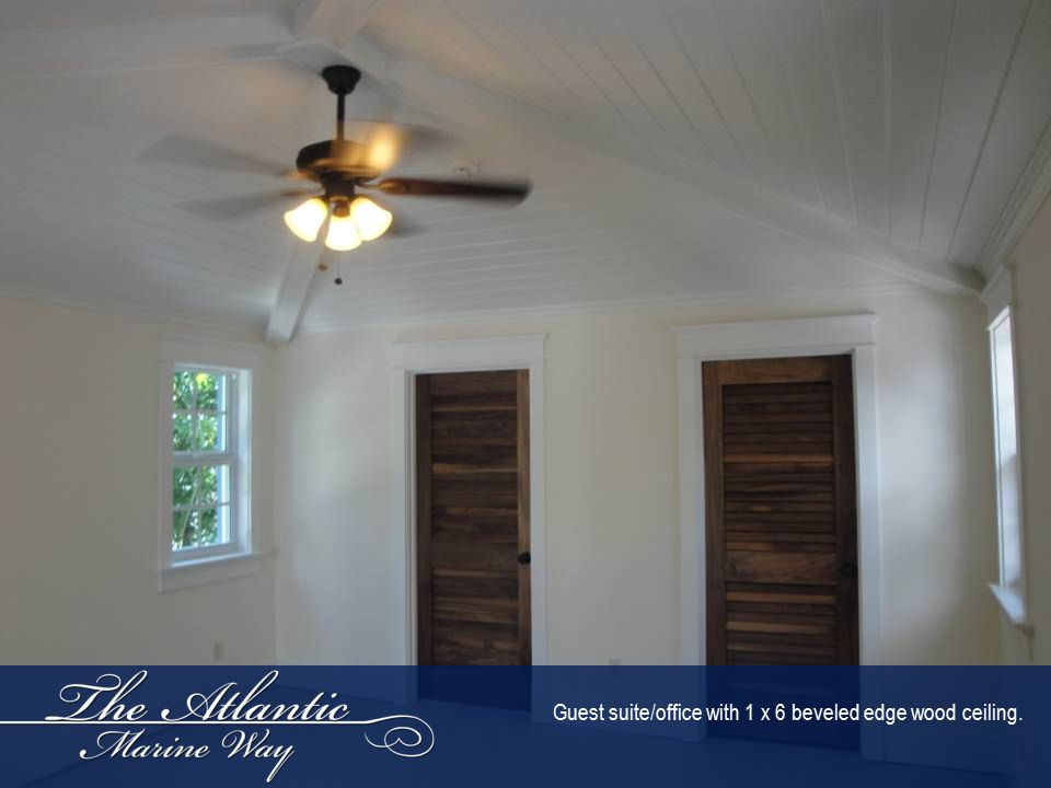 Guest suite/office with 1 x 6 beveled edge wood ceiling.