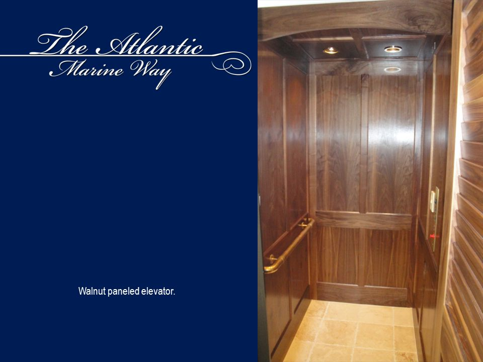 Walnut paneled elevator.