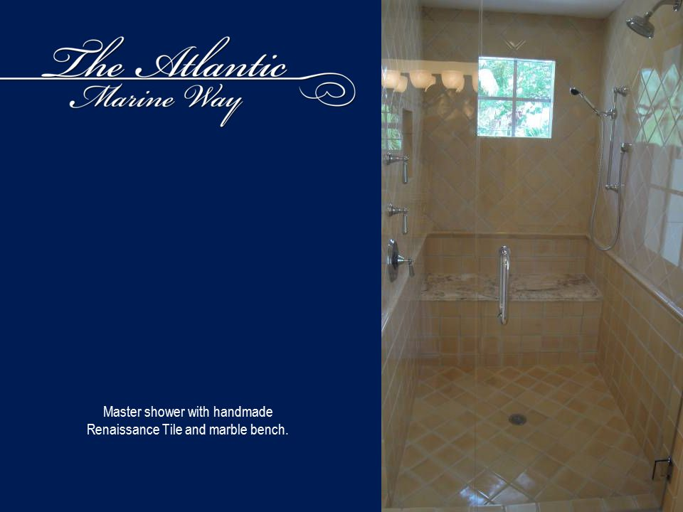 Master shower with handmade Renaissance Tile and marble bench.