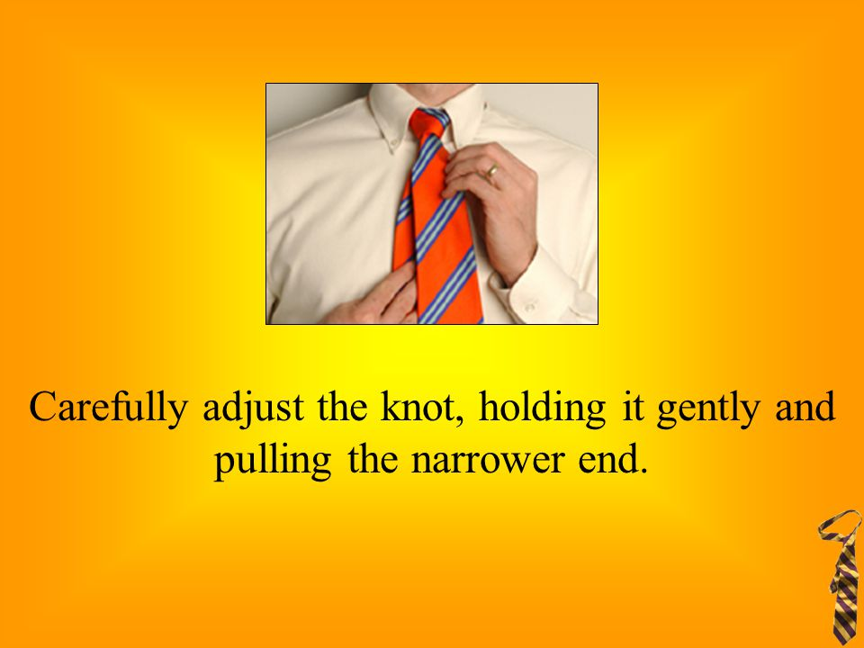 Carefully adjust the knot, holding it gently and pulling the narrower end.