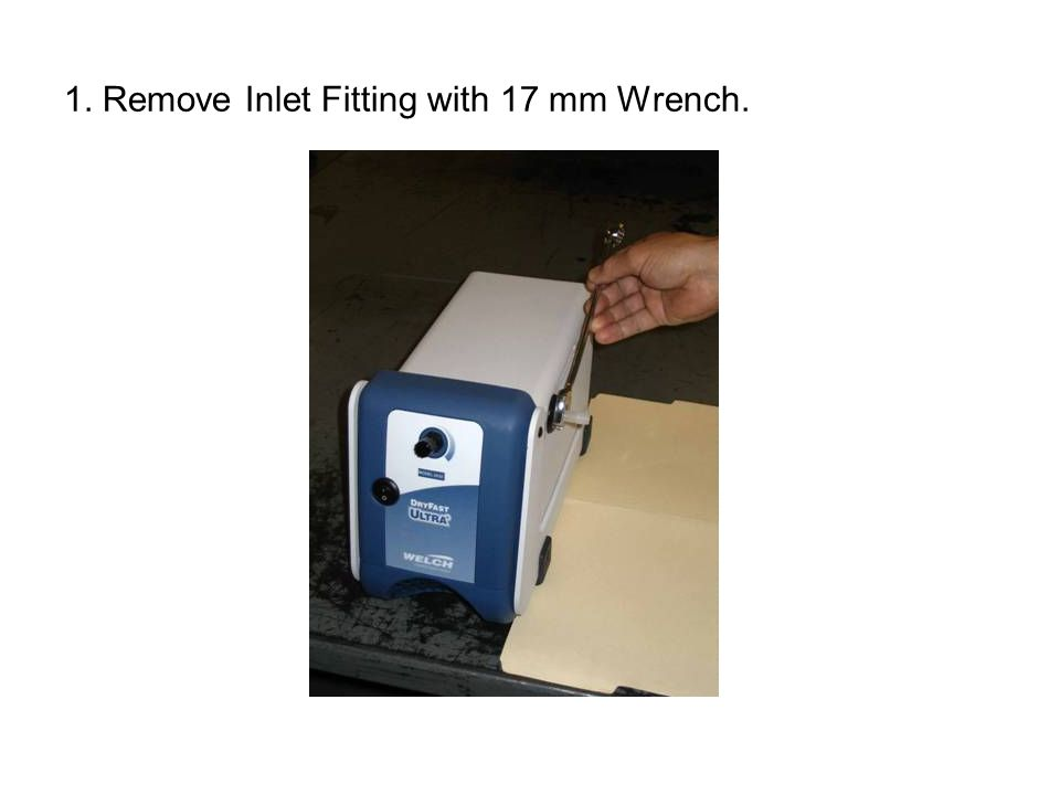 1. Remove Inlet Fitting with 17 mm Wrench.