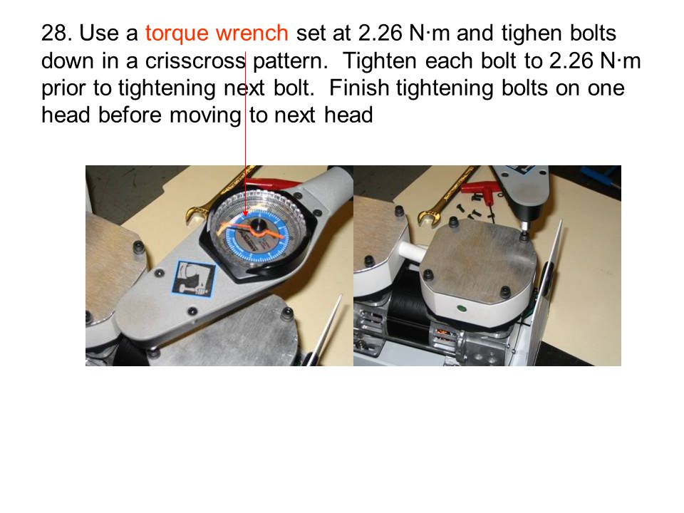 28. Use a torque wrench set at 2.26 N·m and tighen bolts down in a crisscross pattern. Tighten each bolt to 2.26 N·m prior to tightening next bolt. Fi