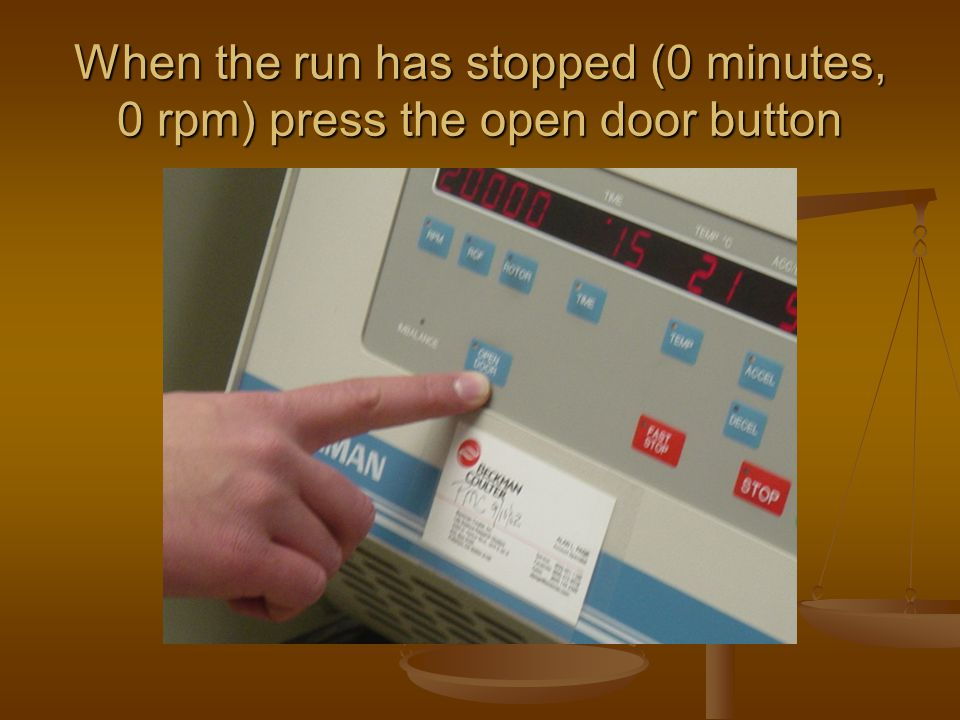 When the run has stopped (0 minutes, 0 rpm) press the open door button