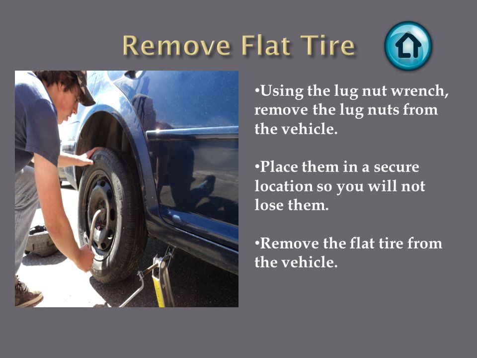 Using the lug nut wrench, remove the lug nuts from the vehicle.