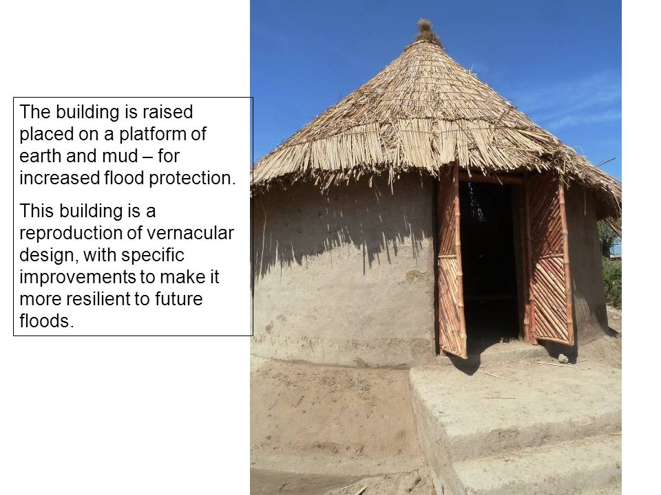 The building is raised placed on a platform of earth and mud – for increased flood protection.