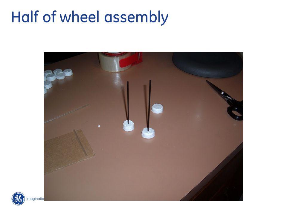 Insert axle to second wheel