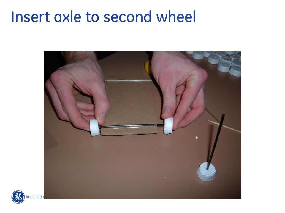 Insert axle to second wheel