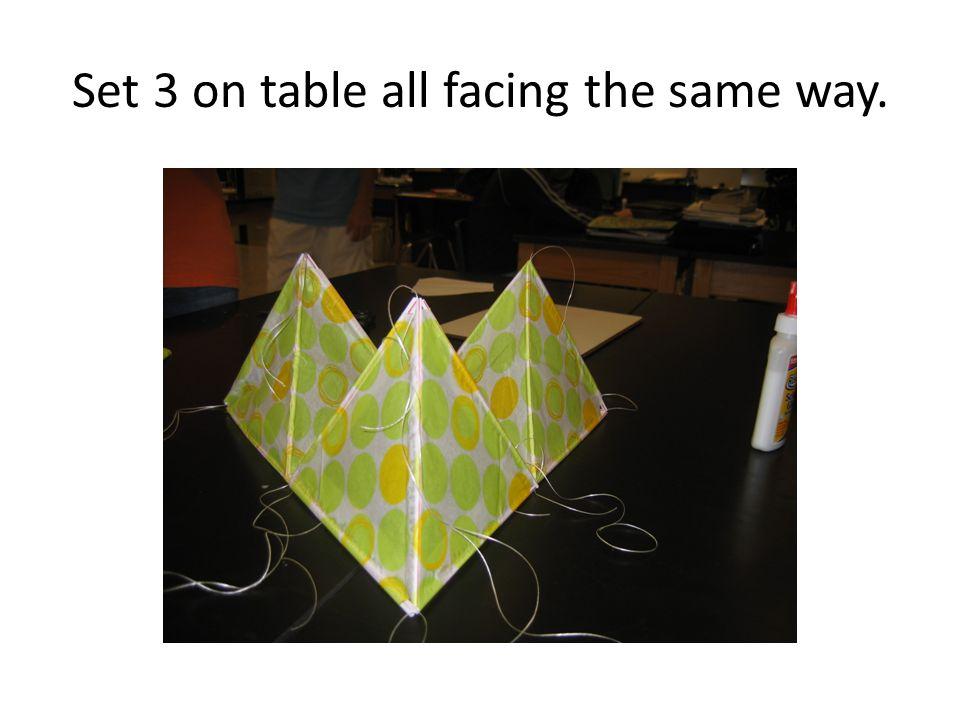 Set 3 on table all facing the same way.