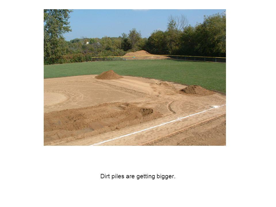 Dirt piles are getting bigger.