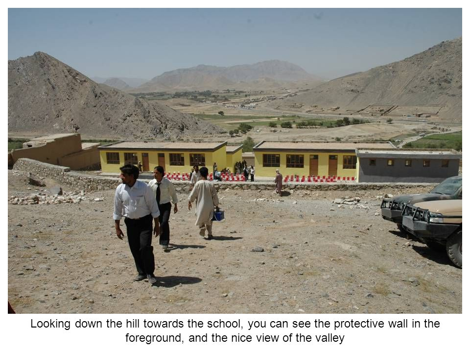 Different school items being handed out to children from the Afghanistan National Army