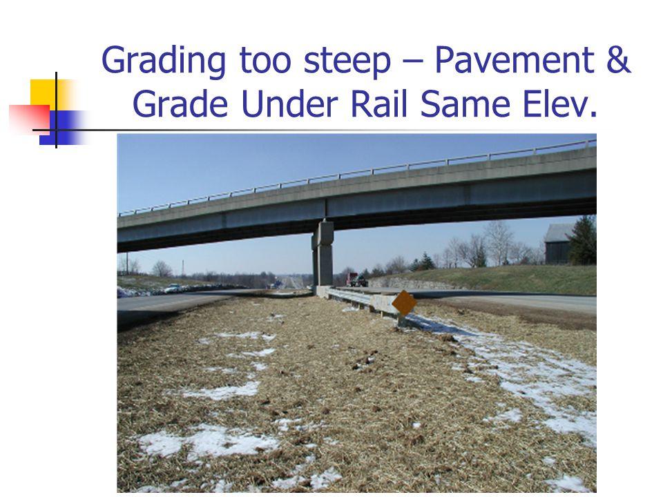 Grading too steep – Pavement & Grade Under Rail Same Elev.