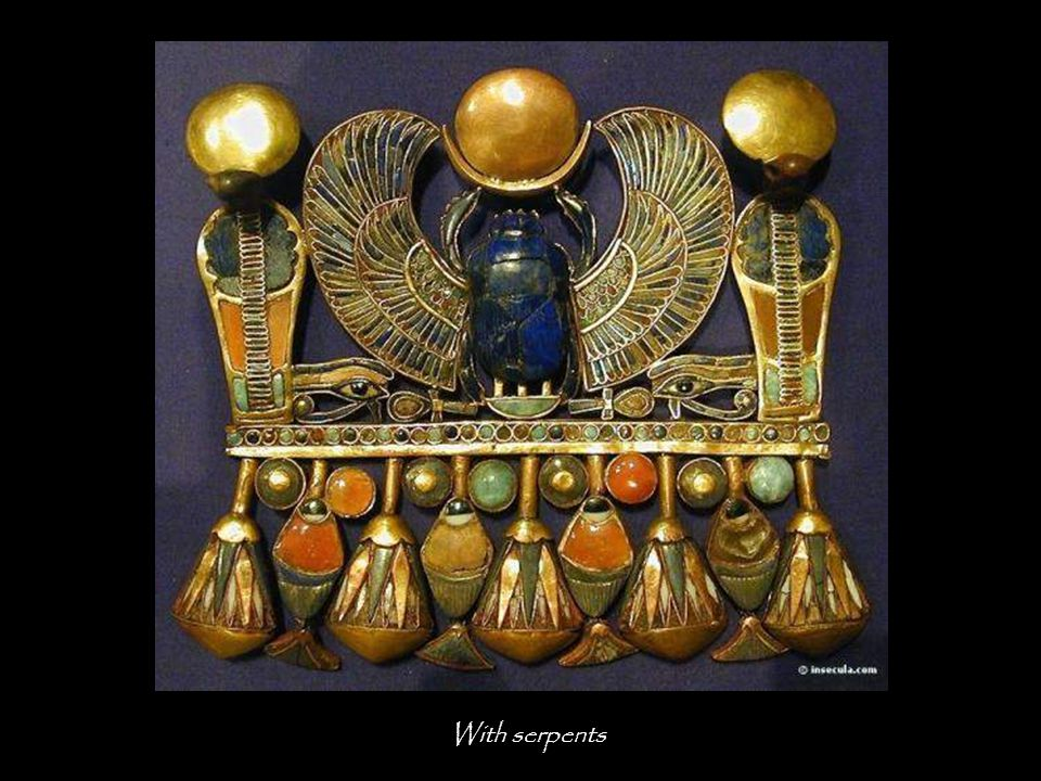 Pectoral necklace with beetles and baboons The beetle, in the divine barge, represents the god Sol in aurora.