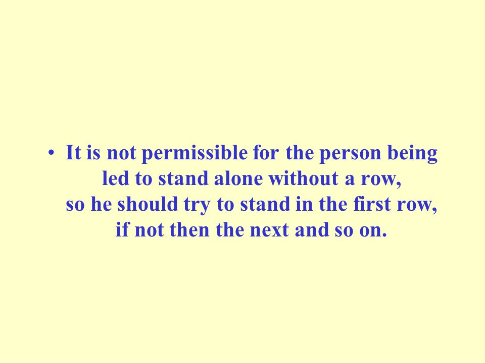 It is not permissible for the person being led to stand alone without a row, so he should try to stand in the first row, if not then the next and so on.