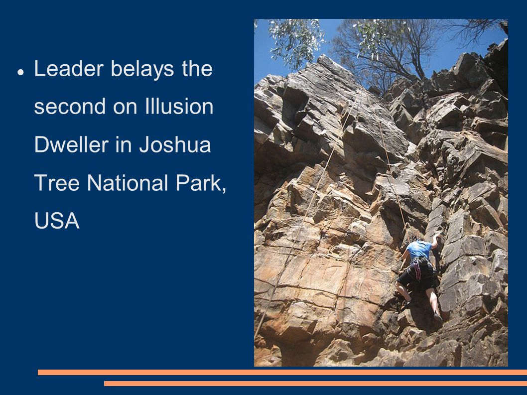Leader belays the second on Illusion Dweller in Joshua Tree National Park, USA